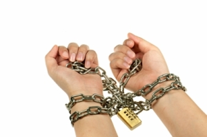 Image of a woman's hands in chains